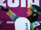 Jarryd Hughes of Australia celebrates after his heat  in the Men's Snowboard Cross 1/8 Finals.