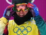 Cameron Bolton looks on after the Men's Snowboard Cross 1/8 Finals on day eleven of the 2014 Winter Olympics.