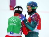 Lucas Eguibar of Spain (green bib) and Alex Pullin (red bib) embrace after the Men's Snowboard Cross Quarterfinals on day eleven of the 2014 Winter Olympics.
