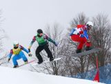 Hanno Douschan of Austria (yellow bib), Jarryd Hughes of Australia (green bib) and Pierre Vaultier of France (red bib) compete in the Men's Snowboard Cross 1/8 Finals on day eleven of the 2014 Winter Olympics at Rosa Khutor Extreme Park on February 18, 2014 in Sochi, Russia.
