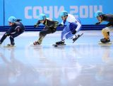 (L to R) Se Yeong Park of Korea,  Satoshi Sakashita of Japan, Vladislav Bykanov of Israel and Pierre Boda compete in the Short Track Men's 500m Heat at Iceberg Skating Palace.