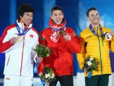 (L-R) Bronze medalist Jia Zongyang of China, gold medalist Anton Kushnir of Belarus and silver medalist David Morris  celebrate on the podium during the medal ceremony for the Freestyle Skiing Men's Aerials Finals.