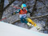 Dominic Demschar of Australia in action during the Alpine Skiing Men's Giant Slalom on day 12 of the Sochi 2014 Winter Olympics.