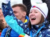 A fan cheers during the Snowboard Parallel Giant Slalom Finals on day twelve of the 2014 Winter Olympics.