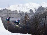 Anton Grimus and Scott Kneller of Australia jump during a Ski Cross training session at Rosa Khutor Extreme Park on day 12 of the Sochi Winter Olympics.
