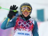 Katya Crema waves in the Freestyle Skiing Womens' Ski Cross Seeding on day 14 of the 2014 Winter Olympics.