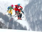 (L-R) Sandra Naeslund of Sweden, Jorinde Mueller of Switzerland and Jenny Owens compete in the Freestyle Skiing Womens' Ski Cross 1/8 Finals on day 14 of the 2014 Winter Olympics.