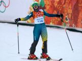 Greta Small reacts after her first run during the Women's Slalom during day 14 of the Sochi 2014 Winter Olympics.