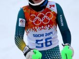 Lavinia Chrystal smiles after her first run during the Women's Slalom during day 14 of the Sochi 2014 Winter Olympics.