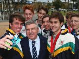 IOC President Thomas Bach takes a selfie with Australian Junior Fencing squad members outside the Olympic Stadium on April 29, 2015 in Sydney, Australia.