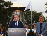 IOC President Thomas Bach speaks in front of the Olympic Cauldron and alongside Susie O'Neill at Sydney Olympic Park on April 29, 2015 in Sydney, Australia.