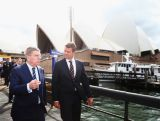 IOC President Thomas Bach speaks with NSW Premier Mike Baird outside the Sydney Opera House on April 29, 2015 in Sydney, Australia.