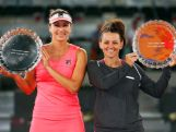 Casey Dellacque and Yaroslava Shvedova of Kazakhstan with the winners trophies after their win over Spain in the doubles final during day eight of the Mutua Madrid Open tennis tournament on May 9, 2015 in Madrid, Spain.