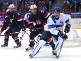 Teemu Selanne #8 of Finland handles the puck against Justin Faulk #72 of the United States in the second period during the Men's Ice Hockey Bronze Medal Game on Day 15 of the 2014 Sochi Winter Olympics.