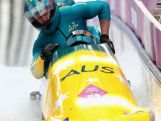 Pilot Heath Spence, Gareth Nichols, Duncan Harvey and Lucas Mata of Australia team 1 finish a run during the Men's Four-Man Bobsleigh on Day 16 of the Sochi 2014 Winter Olympics.