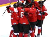 Canada players celebrate their 3-0 victory during the Men's Ice Hockey Gold Medal match against Sweden on Day 16 of the 2014 Sochi Winter Olympics.