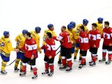 The victorious Canada players shake hands with the Sweden team following their 3-0 victory during the Men's Ice Hockey Gold Medal match on Day 16 of the 2014 Sochi Winter Olympics.