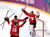 Goalie Carey Price #31 of Canada celebrates his team's 3-0 victory with teammates Dan Hamhuis #5 and Jonathan Toews #16 during the Men's Ice Hockey Gold Medal match on Day 16 of the 2014 Sochi Winter Olympics.