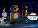 Olympic mascots the Hare, the Polar Bear and the Leopard stand by the Olympic flame during the 2014 Sochi Winter Olympics Closing Ceremony at Fisht Olympic Stadium on February 23, 2014 in Sochi, Russia.