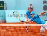 Australia's John Peers and Jamie Murray of Great Britain in action against Mariusz Fyrstenberg and Marcin Matkowski of Poland in their first round doubles match during day five of the Mutua Madrid Open tennis tournament on May 7, 2014 in Madrid, Spain.