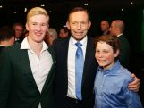 Australian Prime Minister Tony Abbott (C) poses with 2014 Sochi Australian Olympian Jarryd Hughes (L) and 14 year old Paralympian Ben Tudhope (R) during the Official Welcome Home Celebration For The 2014 Sochi Olympians And Paralympians at Museum of Contemporary Art on May 9, 2014 in Sydney, Australia.