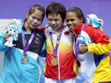 Winners pose for the camera in the women's 48kg weightlifting finals at the Singapore 2010 Youth Olympic Games. Taking the gold medal is Tian Yuan of China (centre), with silver medallist, Sirivimon Pramongkhol of Thailand (left) and broze medallist, Genesis Rodriguez of Venezuela (right).