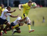 Tom Cusack of Australia in action during the World Sevens Oceania Olympic Qualification match between Australia and Nauru  on November 14, 2015 in Auckland, New Zealand.