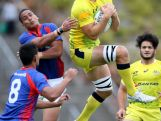 Jesse Parahi of Australia takes a high ball during the World Sevens Oceania Olympic Qualification match between Australia and American Samoa on November 15, 2015 in Auckland, New Zealand.