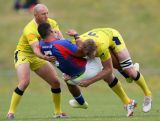 Maugalei Ve'ave'a of American Samoa is tackled by Tom Cusack of Australia during the World Sevens Oceania Olympic Qualification match between Australia and American Samoa on November 15, 2015 in Auckland, New Zealand.