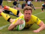Henry Hutchison of Australia scores a try during the World Sevens Oceania Olympic Qualification Semi-Final match between Australia and Papua New Guinea on November 15, 2015 in Auckland, New Zealand.