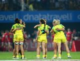Australian players celebrate after beating Russia to win the World Rugby Women's Sevens Series Cup Final on December 4, 2015 in Dubai