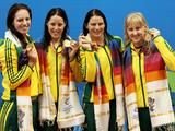 (L-R) Emily Seebohm, Alicia Coutts Leisel Jones and Jessicah Schipper pose with their gold medals during the medal ceremony for the Women's 4x100m Medley Relay Final at the Delhi 2010 Commonwealth Games.