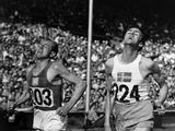 London 1948: Erik Ahlden (right) of Sweden beats Emil Zatopek (1922-2000) of Czechoslovakia to the tape, in the second heat of the Olympic 5,000m. In the final Ahlden finished fourth and Zatopek came second.