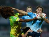 Ekaterina Vorontsova of Russia is tackled by Ellia Green of Australia during the Dubai Rugby Sevens on December 4, 2015.
