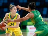 Katie Rae Ebzery drives the ball against Palmira Marcal of Brazil during International Womens Basketball Tournament - Aquece Rio Test Event.