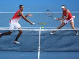 Ajla Tomljanovic and Nick Kyrgios during their first round mixed doubles match against Sania Mirza of India and Ivan Dodig of Croatia during day six of the 2016 Australian Open.