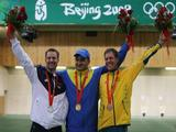 (L-R) Silver medalist Matthew Emmons, gold medalist Artur Ayvazian of Ukraine and bronze medalist Warren Potent of Australia pose with their medals after the Men's 50m Rifle Prone Final.