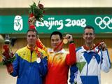 (L-R) Silver medalist Jury Sukhorukov, Gold medalist Qiu Jian of China and Bronze medalist Rajmond Debevec of Slovenia pose after the men's 50m rifle 3 positions final held at the Beijing Shooting Range Hall.