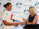 Australian Chef de Mission Kitty Chiller presents Ian Borrows with his Qantas boarding pass to Rio during the Australian Rio 2016 Olympic Games canoe slalom team announcement on February 25, 2016 in Sydney, Australia.