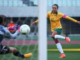Kyah Simon scores her team's fourth goal past Dang Thi Kieu Trinh of Vietnam during the AFC Women's Olympic Final Qualification Round match between Australia and Vietnam on March 2, 2016 in Osaka, Japan.