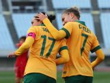 Kyah Simon celebrates scoring her team's fifth and hat trick goal with team mate Stephanie Catley during the AFC Women's Olympic Final Qualification Round match between Australia and Vietnam on March 2, 2016 in Osaka, Japan.