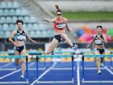 Lauren Wells competes in the Women's 400m hurdles final during the Australian Athletics Championships at Sydney Olympic Park on April 3, 2016.