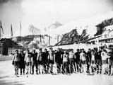 St Moritz 1924: Members of the Canadian and Swedish hockey teams line up on an outdoor ice rink after the final where the Canadian team won the gold medal and the Swedish team won the silver. The Swiss Alps are in the background.