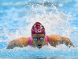 Emma McKeon of Australia competes in the Women's 100 Metre Butterfly during day two of the 2016 Australian Swimming Championships.