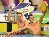 Thomas Fraser-Holmes of Australia celebrates winning and Cameron McEvoy celebrates coming second in the Men's 200 Metre Freestyle during day three of the Australian Swimming Championships.