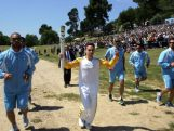 The first torchbearer and reigning world champion gymnast Lefteris Petrounias runs with the torch during the Lighting Ceremony of the Olympic Flame for the Rio Olympic Games on April 21, 2016 in Olympia, Greece.