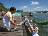 Ovelejador Felipe Rondina passes the flame to the canoeist Rubens Pompey during the Olympic Flame torch relay on May 3, 2016 in Brasilia, Brazil.