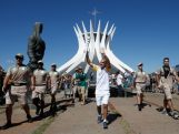 Former Marathon runner Vanderlei Cordeiro with runs with the Olympic Torch in front of the Cathedral of Brasilia during the Olympic Flame torch relay on May 3, 2016 in Brasilia, Brazil.