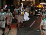 The gymnast Rebecca Andrade leads the Olympic torch during Day 2 of the Olympic Flame torch relay on May 4, 2016 in Anapolis, Brazil.