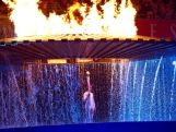 The Cauldron containing the Olympic Flame rises above Torch Bearer Cathy Freeman of Australia during the Opening Ceremony of the Sydney 2000 Olympic Games at the Olympic Stadium in Homebush.